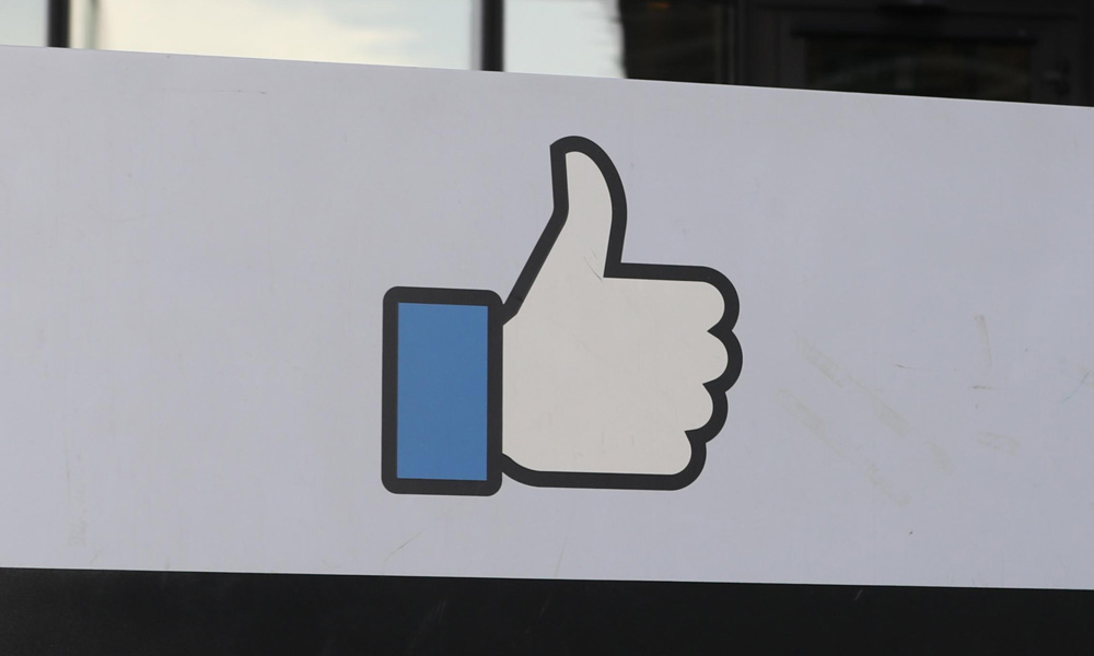 "Facebook ""Like"" hand outside building"